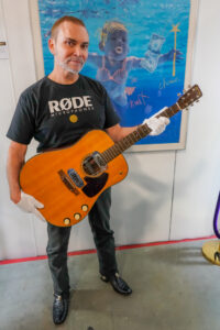 Rode Microphone Founder With Kurt Cobain's Unplugged Guitar